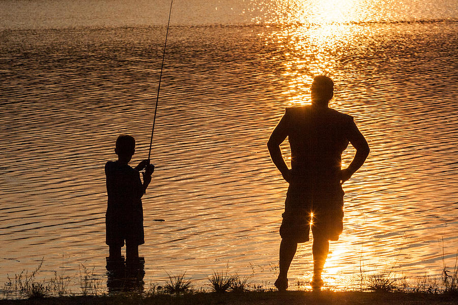 father-and-son-fishing-at-sunset-aaron-baker